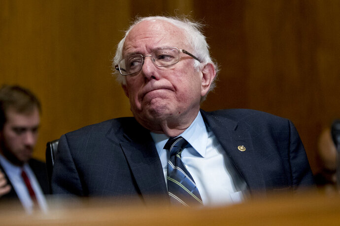 """FILE - In this Jan. 16, 2019, file photo Sen. Bernie Sanders, I-Vt., attends a hearing on Capitol Hill in Washington. Some of the 2020 Democratic presidential hopefuls are forging ahead with """"Medicare-for-all,"""" but others are taking a more cautious approach. Proponents like Sanders, hold out the promise of health care as right, the potential for national savings, and no more copays, deductibles or surprise medical bills.(AP Photo/Andrew Harnik, File)"""