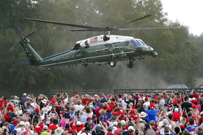 President Donald Trump arrives in the Marine One helicopter at a campaign rally as supporters cheer Friday, Oct. 23, 2020, in The Villages, Fla. (AP Photo/John Raoux)