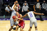 Wisconsin guard Jonathan Davis, center, drives against Northwestern guard Chase Audige, left, and guard Anthony Gaines during the first half of an NCAA college basketball game in Evanston, Ill., Saturday, Feb. 21, 2021. (AP Photo/Nam Y. Huh)