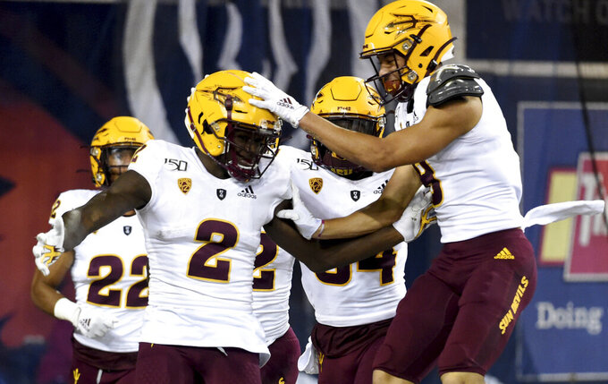 Arizona State wide receiver Brandon Aiyuk celebrates with teammates after running a punt back for a touchdown during the first half of an NCAA college football game against Oregon State in Corvallis, Ore., Saturday, Nov. 16, 2019. (AP Photo/Steve Dykes)