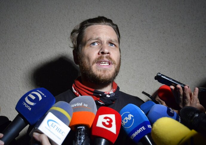 Jock Palfreeman speaks to journalists as he leaves migrants' detention centre in Busmantsi, Bulgaria, Tuesday, Oct. 15, 2019. Australian man Palfreeman was convicted of fatally stabbing a Bulgarian student during a 2007 brawl and has been paroled after serving 11-years of his 20-year prison sentence, but then held back in a detention centre after a prosecutors' petition to revoke the parole. (AP Photo)