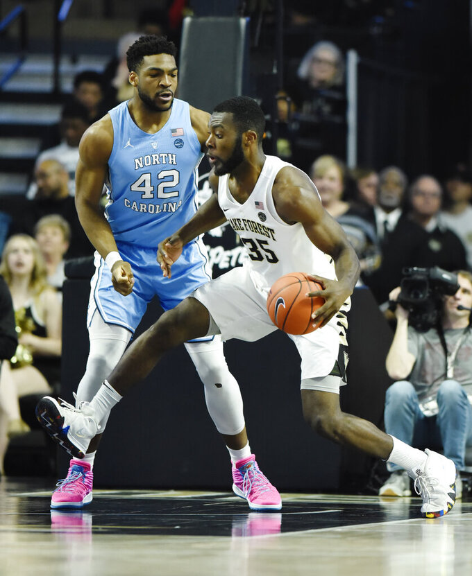 Wake Forest's Ikenna Smart (35) makes a move to the basket as North Carolina's Brandon Huffamn defends (42) during the second half of an NCAA college basketball game in Winston-Salem, N.C.,  Saturday, Feb 16, 2019. (AP Photo/Woody Marshall)