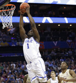 Duke's Zion Williamson (1) dunks against Florida State during the first half of the NCAA college basketball championship game of the Atlantic Coast Conference tournament in Charlotte, N.C., Saturday, March 16, 2019. (AP Photo/Chuck Burton)