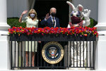 FILE - In this Monday, April 5, 2021 file photo, President Joe Biden and first lady Jill Biden wave from the Blue Room balcony as they participate in an Easter event at the White House in Washington. The annual East Egg Roll at the White House was canceled due to the ongoing pandemic. On Friday, April 9, 2021, The Associated Press reported on stories circulating online incorrectly asserting Biden needed a special medical team at the White House and was taken to the hospital late Sunday. But Biden was not at the White House on Easter Sunday; he celebrated the holiday at Camp David. Biden returned to Washington via Marine One around noon on Monday, according to reporting by The Associated Press. (AP Photo/Evan Vucci)