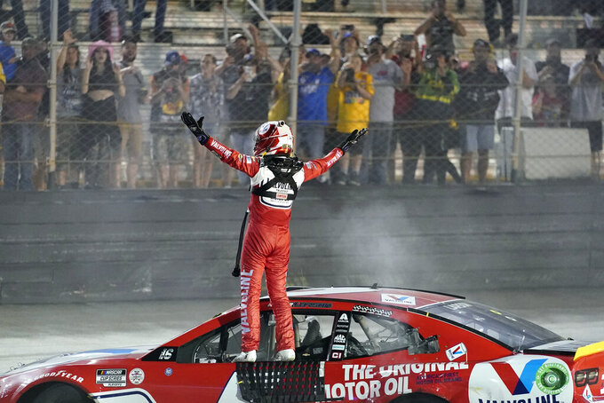 Kyle Larson gets out of his car after winning a NASCAR Cup Series auto race at Bristol Motor Speedway Saturday, Sept. 18, 2021, in Bristol, Tenn. (AP Photo/Mark Humphrey)