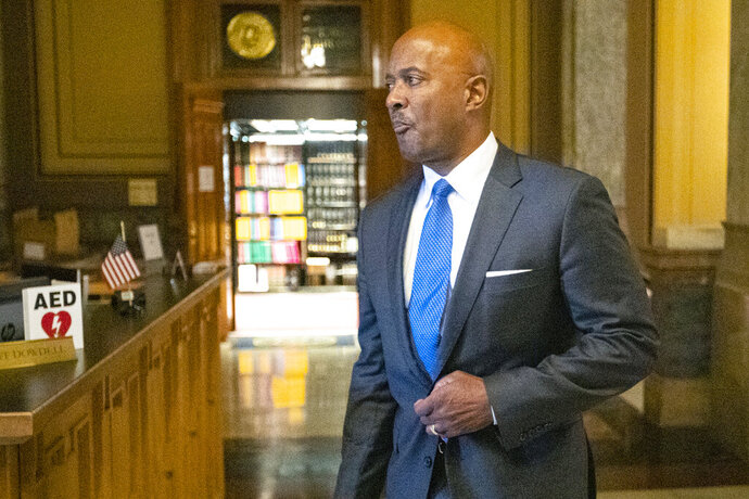 """FILE - In this Oct. 23, 2019 file photo, Indiana Attorney General Curtis Hill arrives for a hearing at the state Supreme Court in the Statehouse, in Indianapolis. Hill is running for reelection as he awaits the outcome from professional misconduct allegations of drunkenly groping four women that threaten his law license.  Hill announced his bid for a second term Thursday, Nov. 14, 2019, releasing a video in which he says  he won't back down from """"partisan attacks, the media, and even Republicans embarrassed to defend our values."""" (AP Photo/Michael Conroy File)"""