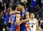 Florida guard Andrew Nembhard (2) is hugged by Jalen Hudson after Nembhard hit the winning 3-point basket against LSU in the second half of an NCAA college basketball game at the Southeastern Conference tournament Friday, March 15, 2019, in Nashville, Tenn. Florida won 76-73. At right is LSU guard Skylar Mays (4). (AP Photo/Mark Humphrey)