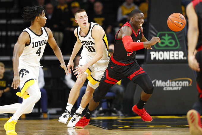 SIU-Edwardsville guard Mike Adewunmi, right, runs down a loose ball ahead of Iowa's Bakari Evelyn, left, and Joe Wieskamp (10) during the first half of an NCAA college basketball game, Friday, Nov. 8, 2019, in Iowa City, Iowa.(AP Photo/Charlie Neibergall)