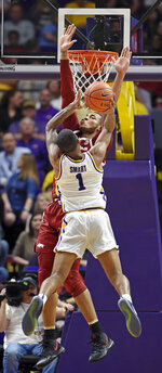 Arkansas forward Daniel Gafford (10) defends as LSU guard Ja'vonte Smart (1) drives to the basket during the second half of an NCAA college basketball game Saturday, Feb. 2, 2019, in Baton Rouge, La. Arkansas won 90-89. (AP Photo/Bill Feig)