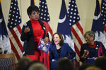 Actress Sheryl Lee Ralph, left, speaks at a round table with Democratic presidential hopeful Kamala Harris, center, on Saturday, Nov. 23, 2019, in Columbia, S.C. (AP Photo/Meg Kinnard)