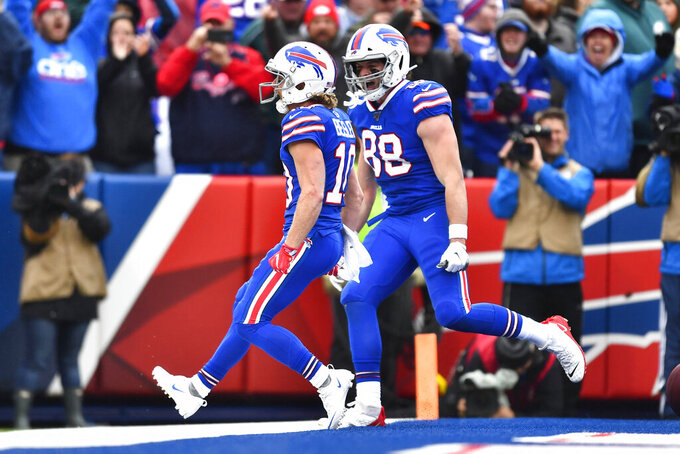 Buffalo Bills' Cole Beasley, left, and Dawson Knox reacts after Beasley scored a touchdown during the first half of an NFL football game against the Philadelphia Eagles, Sunday, Oct. 27, 2019, in Orchard Park, N.Y. (AP Photo/Adrian Kraus)