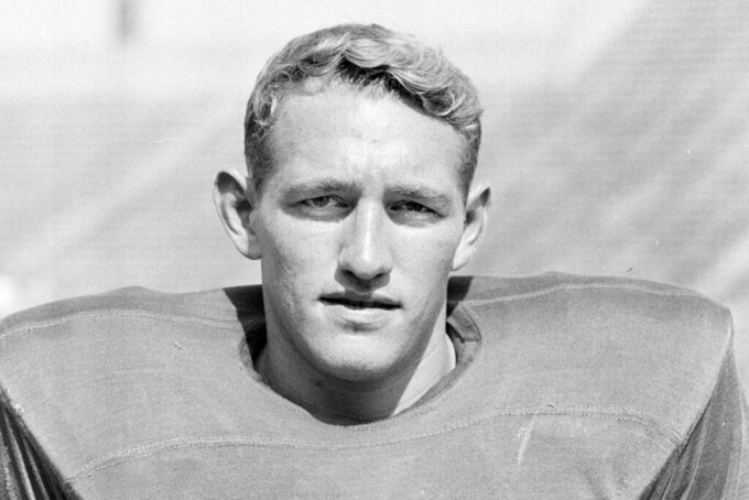 FILE - This is a Sept. 8, 1953, file photo showing Michigan State NCAA college football player Henry Bullough. Henry Bullough, whose play and coaching on the football field at Michigan State put him in its athletics hall of fame, has died. He was 85.  Chuck Bullough, one of his sons, is an assistant coach for the Spartans under Mark Dantonio and the school announced his death Monday, Nov. 25, 2019. (AP Photo/Phil Sandlin, File)