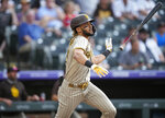 San Diego Padres' Fernando Tatis Jr. tosses his bat after hitting a two-run home run off Colorado Rockies starting pitcher Chi Chi Gonzalez during the first inning of a baseball game Tuesday, June 15, 2021, in Denver. (AP Photo/David Zalubowski)
