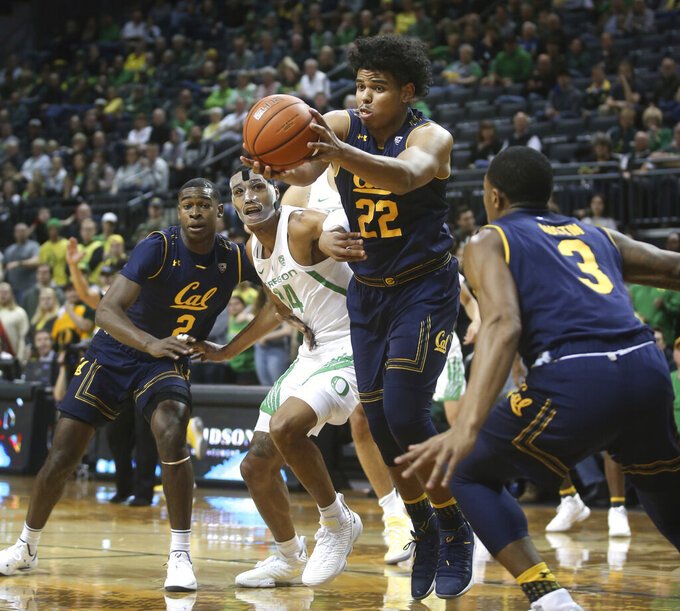 California's Audre Kelly, center grabs a rebound ahead of teammate Juhwan Harris-Dyson, left, Oregon's Kenny Wooten and California's Paris Austin, right, during the first half of an NCAA college basketball game Wednesday, Feb. 6, 2019, in Eugene, Ore. (AP Photo/Chris Pietsch)