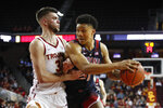 Arizona's Ira Lee, right, is defended by Southern California's Nick Rakocevic during the second half of an NCAA college basketball game Thursday, Jan. 24, 2019, in Los Angeles. USC won 80-57. (AP Photo/Jae C. Hong)