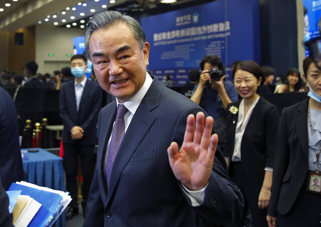 "FILE - In this Sept. 28, 2020, file photo, Chinese Foreign Minister Wang Yi waves after delivering a speech at the Lanting Forum held at the Ministry of Foreign Affairs office in Beijing. While on a current trip to Malaysia, Tuesday, Oct. 13, 2020, Yi says the United States poses a ""huge security risk"" to Asia by pushing to boost engagement with the region. (AP Photo/Andy Wong, File)"