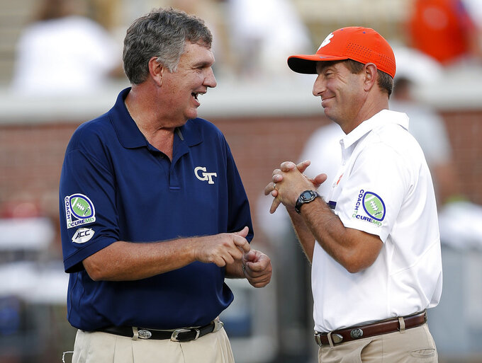 FILE - In this Sept. 22, 2016, file photo, Georgia Tech head coach Paul Johnson, left, and Clemson head coach Dabo Swinney laugh as they speak on the field before an NCAA college football game in Atlanta. The schools meet on Saturday. (AP Photo/John Bazemore, File)