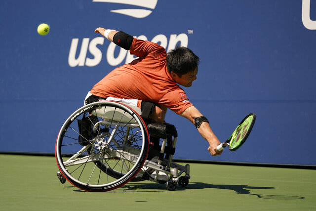 FILE - In this Sept. 7, 2019, file photo, Shinjo Kunieda, of Japan, returns a shot to Alfie Hewett, of the United Kingdom, during the men's wheelchair singles quarterfinals of the U.S. Open tennis championships in New York. The U.S. Tennis Association changed its plans and now will include wheelchair competition at the scaled-down U.S. Open after athletes complained about the original decision to drop their event entirely this year. The USTA announced Wednesday, June 24, 2020, that wheelchair tennis will be played at Flushing Meadows from Sept. 10-13, the last four days of the Grand Slam tournament.(AP Photo/Eduardo Munoz Alvarez, File)