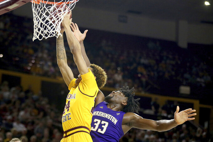 Arizona State's Jalen Graham (24) wins the rebound against Washington's Isaiah Stewart (33) during the first half of an NCAA college basketball game Thursday, March 5, 2020, in Tempe, Ariz. (AP Photo/Darryl Webb)