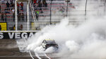 AJ Allmendinger does a burnout after winning a NASCAR Xfinity Series auto race at Las Vegas Motor Speedway, Saturday, March 6, 2021. (Chase Stevens/Las Vegas Review-Journal via AP)