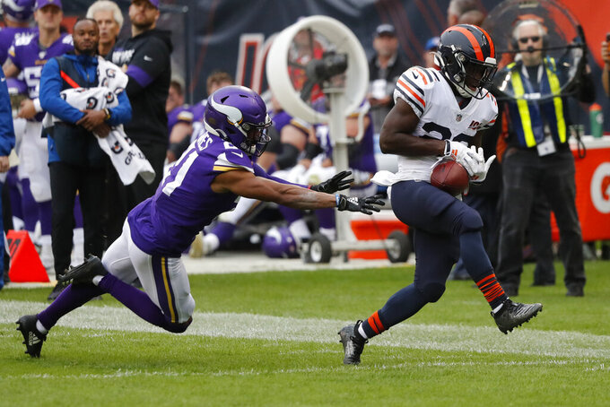 Chicago Bears running back Tarik Cohen, right, is unable to hold on to a pass as Minnesota Vikings cornerback Mike Hughes defends during the half of an NFL football game Sunday, Sept. 29, 2019, in Chicago. (AP Photo/Charles Rex Arbogast)