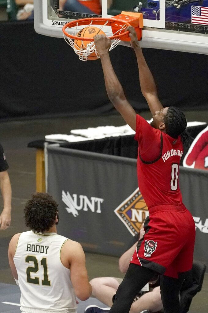 North Carolina State forward DJ Funderburk (0) dunks after getting past Colorado State guard David Roddy (21) in the first half of an NCAA college basketball game in the quarterfinals of the NIT, Thursday, March 25, 2021, in Frisco, Texas. (AP Photo/Tony Gutierrez)