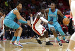Charlotte Hornets guard Terry Rozier (3) drives to the basket as Miami Heat guard Kendrick Nunn defends during the first half of an NBA basketball game, Monday, Nov. 25, 2019, in Miami. (AP Photo/Lynne Sladky)