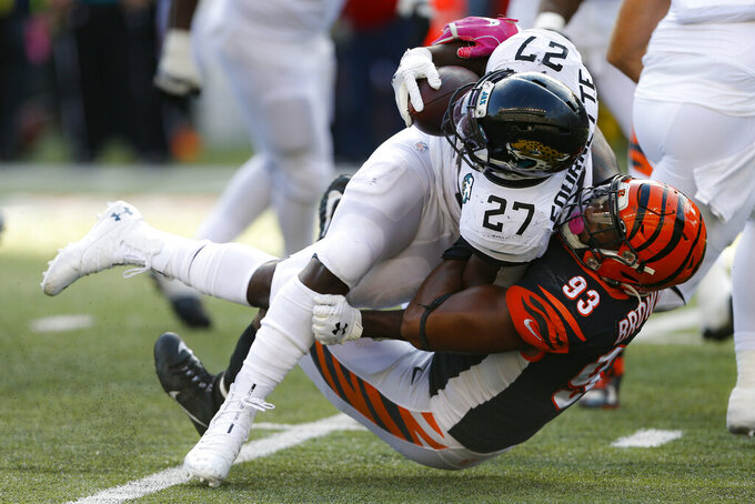 Cincinnati Bengals defensive tackle Andrew Brown (93) tackles Jacksonville Jaguars running back Leonard Fournette (27) in the second half of an NFL football game, Sunday, Oct. 20, 2019, in Cincinnati. (AP Photo/Gary Landers)
