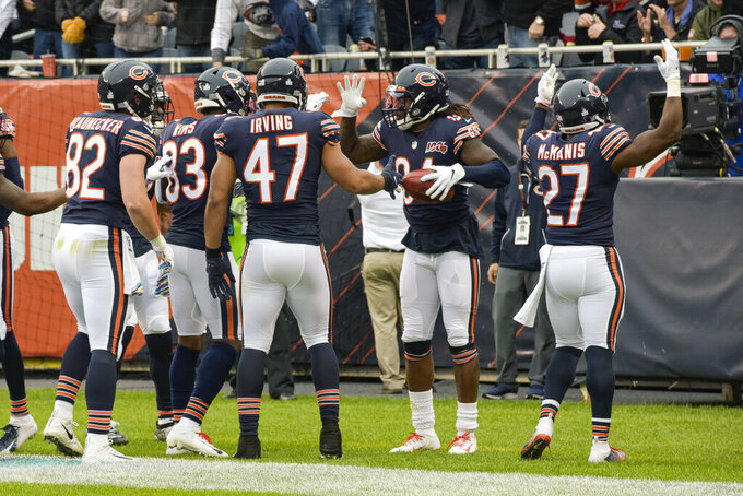 Chicago Bears wide receiver Cordarrelle Patterson (84) celebrates his kickoff return for a touchdown with teammate during the first half of an NFL football game against the New Orleans Saints in Chicago, Sunday, Oct. 20, 2019. (AP Photo/Mark Black)