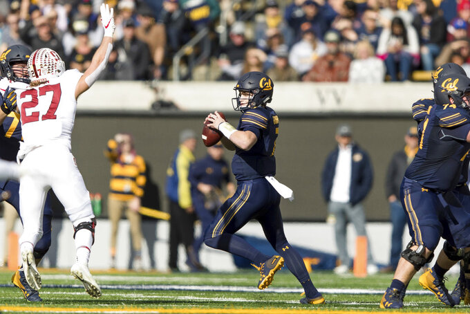 California quarterback Chase Garbers runs the ball against Stanford in the first quarter of a football game in Berkeley, Calif., Saturday, Dec. 1, 2018. (AP Photo/John Hefti)