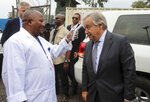 United Nations Secretary-General Antonio Guterres, right, has his temperature taken as a routine measure to stop the spread of Ebola, upon his arrival at the airport in Goma, eastern Congo Saturday, Aug. 31, 2019. Guterres is starting a three-day visit to Congo to see the work of UN peacekeepers, work on disarmament and reintegration of ex-combatants, and efforts to stop the spread of the Ebola virus. (AP Photo/Justin Kabumba)
