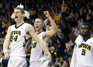 Adam Woodbury, Jarrod Uthoff, Anthony Clemmons