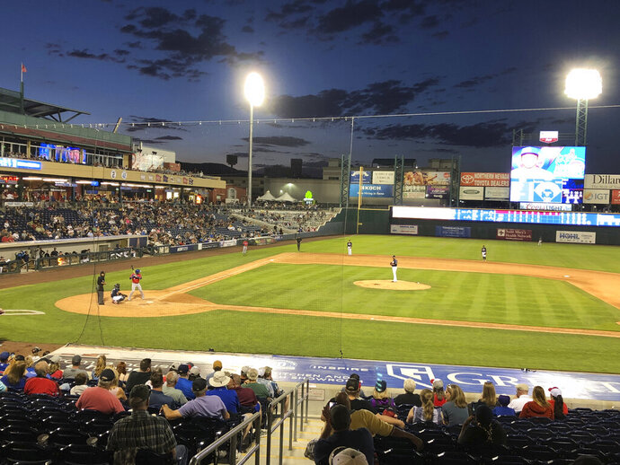 This photo taken Aug. 1, 2019 during a Pacific Coast League baseball game between the Reno Aces and Iowa Cubs at Greater Nevada Field in Reno shows the protective netting that will be extended to the foul poles for the 2020 season. Aces President Eric Edelstein announced Wednesday, Nov. 13, 2019 the installation of the extended netting will begin sometime in December. He says safety is the team's top priority. (AP Photo/Scott Sonner).