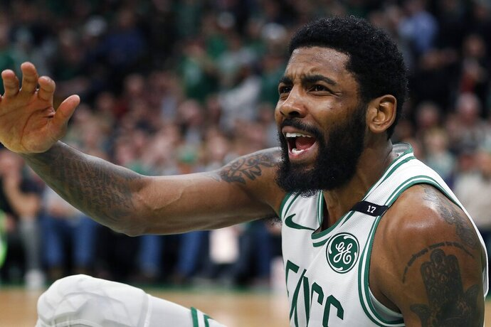 Boston Celtics' Kyrie Irving looks for a foul call against the Milwaukee Bucks after attempting a shot during the second half of Game 3 of a second round NBA basketball playoff series in Boston, Friday, May 3, 2019. (AP Photo/Michael Dwyer)