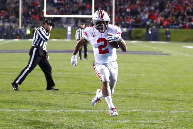 Ohio State running back J.K. Dobbins scores on a pass from quarterback Justin Fields during the first half of an NCAA college football game against Northwestern, Friday, Oct. 18, 2019, in Evanston, Ill. (AP Photo/Charles Rex Arbogast)