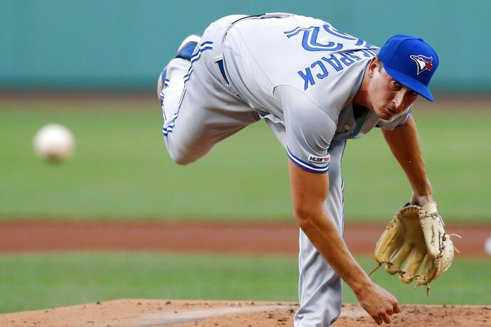 Toronto Blue Jays' Jacob Waguespack pitches during the first inning of the team's baseball game against the Boston Red Sox in Boston, Tuesday, July 16, 2019. (AP Photo/Michael Dwyer)