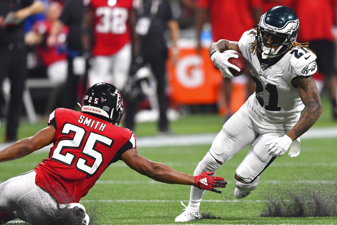 Philadelphia Eagles cornerback Ronald Darby (21) runs near Atlanta Falcons running back Ito Smith (25) during the second half of an NFL football game, Sunday, Sept. 15, 2019, in Atlanta. (AP Photo/John Amis)