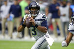 Seattle Seahawks quarterback Russell Wilson (3) looks to throw against the Arizona Cardinals during the second half of an NFL football game, Sunday, Sept. 29, 2019, in Glendale, Ariz. (AP Photo/Ross D. Franklin)