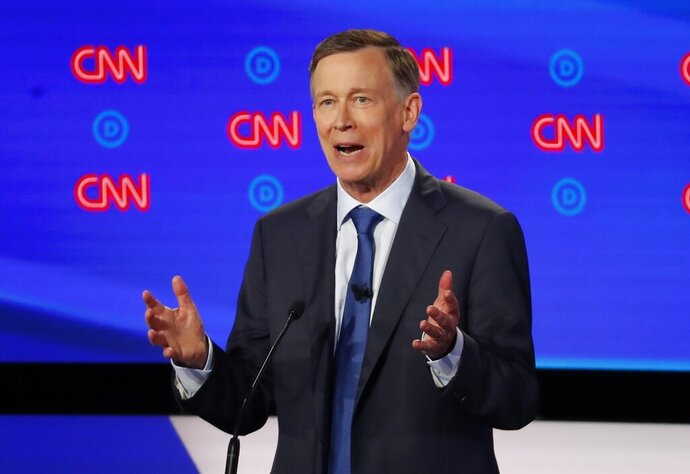 FILE - In this July 30, 2019, file photo, former Colorado Gov. John Hickenlooper speaks during the first of two Democratic presidential primary debates in Detroit. Pressure is mounting on former Hickenlooper to trade in his faltering presidential bid for a U.S. Senate run in his home state. (AP Photo/Paul Sancya, File)