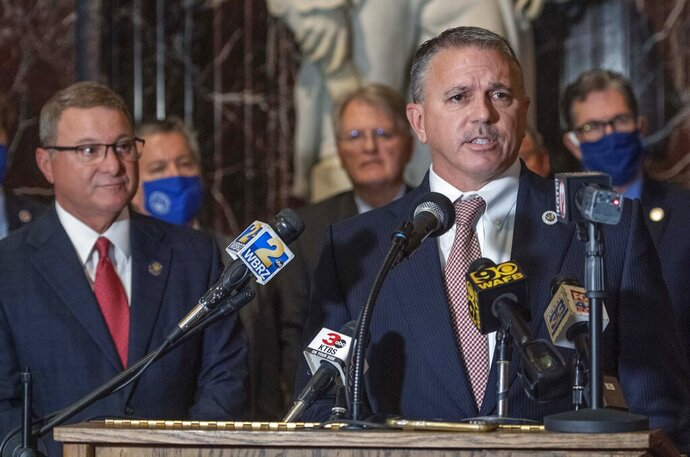 House Speaker Clay Schexnayder, R-Gonzales, at lectern, and Senate President Page Cortez, R-Lafayette, left, answer questions at a news conference in Memorial Hall before the start of the Special Legislative Session, Monday, Sept. 28, 2020, in Baton Rouge, La. (Bill Feig/The Advocate via AP)