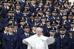 Pope Francis poses with a group of Italian police officers during his weekly general audience, in St. Peter's Square at the Vatican, Wednesday, Nov. 27, 2019. (AP Photo/Andrew Medichini)