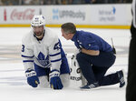 Toronto Maple Leafs center Nazem Kadri (43) looks up from the ice as he is attended to by a trainer after taking a hit during the second period of Game 2 of an NHL hockey first-round playoff series against the Boston Bruins, Saturday, April 13, 2019, in Boston. (AP Photo/Mary Schwalm)