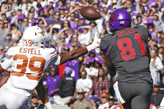 TCU tight end Pro Wells (81) catches a touchdown pass as Texas defensive back Montrell Estell (39) defends in the first half of an NCAA college football game in Fort Worth, Texas, Saturday, Oct. 26, 2019. (AP Photo/Louis DeLuca)