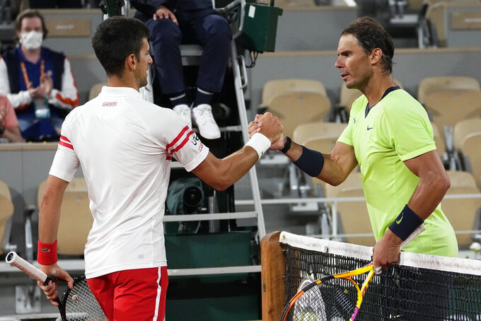 Serbia's Novak Djokovic, left, shakes hands with Spain's Rafael Nadal after their semifinal match of the French Open tennis tournament at the Roland Garros stadium Friday, June 11, 2021 in Paris. Novak Djokovic won 3-6, 6-3, 7-6 (4), 6-2. (AP Photo/Michel Euler)