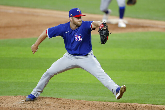 Texas Rangers pitcher Cody Allen throws to the plate during an intrasquad practice baseball game at Globe Life Field in Arlington, Texas, Monday, July 6, 2020. (AP Photo/Tony Gutierrez)