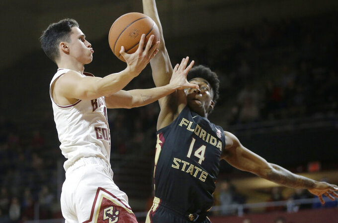 Boston College's Chris Herren Jr., left, drives toward the basket past Florida State's Terance Mann, right, in the second half of an NCAA college basketball game, Sunday, Jan. 20, 2019, in Boston. (AP Photo/Steven Senne)
