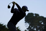 Tiger Woods hits his tee shot on the second hole during the second round of the PGA Championship golf tournament at TPC Harding Park Friday, Aug. 7, 2020, in San Francisco. (AP Photo/Charlie Riedel)