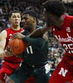 Nebraska guard Nana Akenten (25) reaches in and fouls Michigan State forward Aaron Henry (11) during the second half of an NCAA college basketball game, Tuesday, March 5, 2019, in East Lansing, Mich. (AP Photo/Carlos Osorio)