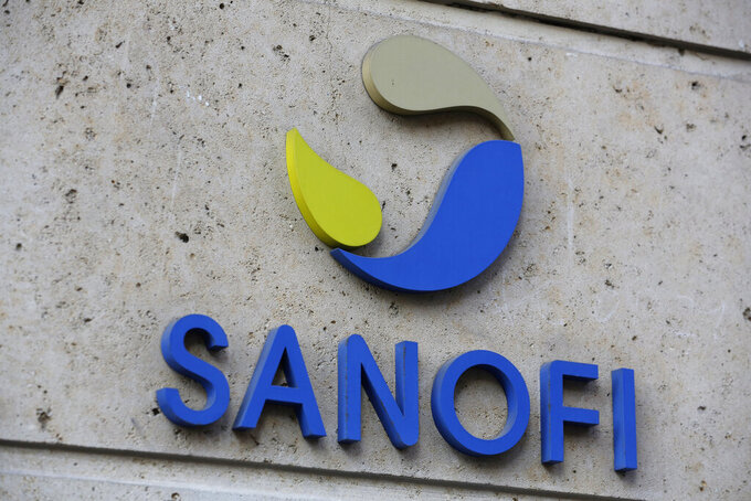 FILE - In this photo Nov.30, 2020 file photo the logo of French drug maker Sanofi is picture at the company's headquarters, in Paris. Sanofi and GlaxoSmithKline's potential COVID-19 vaccine triggered strong immune responses in all adult age groups in preliminary trials, boosting optimism that the shot may join the fight against the pandemic by the end of this year. (AP Photo/Thibault Camus, File)