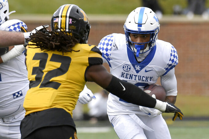Kentucky running back Asim Rose Jr. runs with the ball as Missouri linebacker Nick Bolton (32) defends during the first half of an NCAA college football game Saturday, Oct. 24, 2020, in Columbia, Mo. (AP Photo/L.G. Patterson)